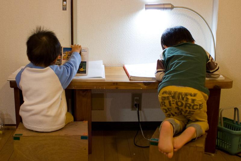 little boys at a desk