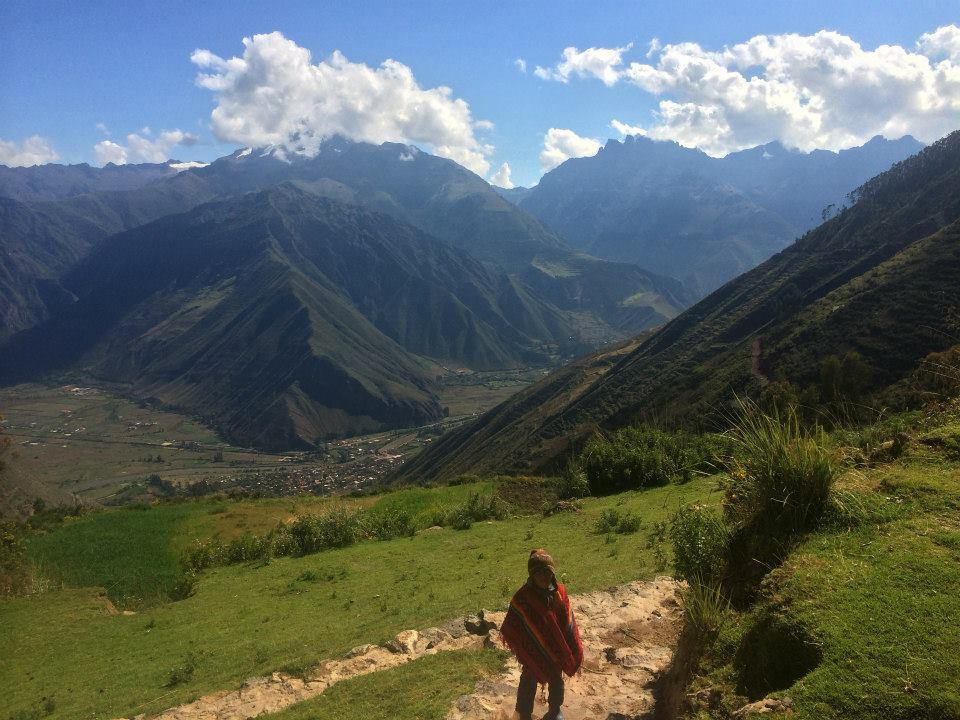 Young Peruvian standing in the mountains