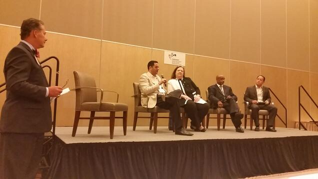 on stage panel at GNEMSDC conference