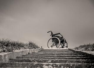 wheel chair sitting at the top of a staircase