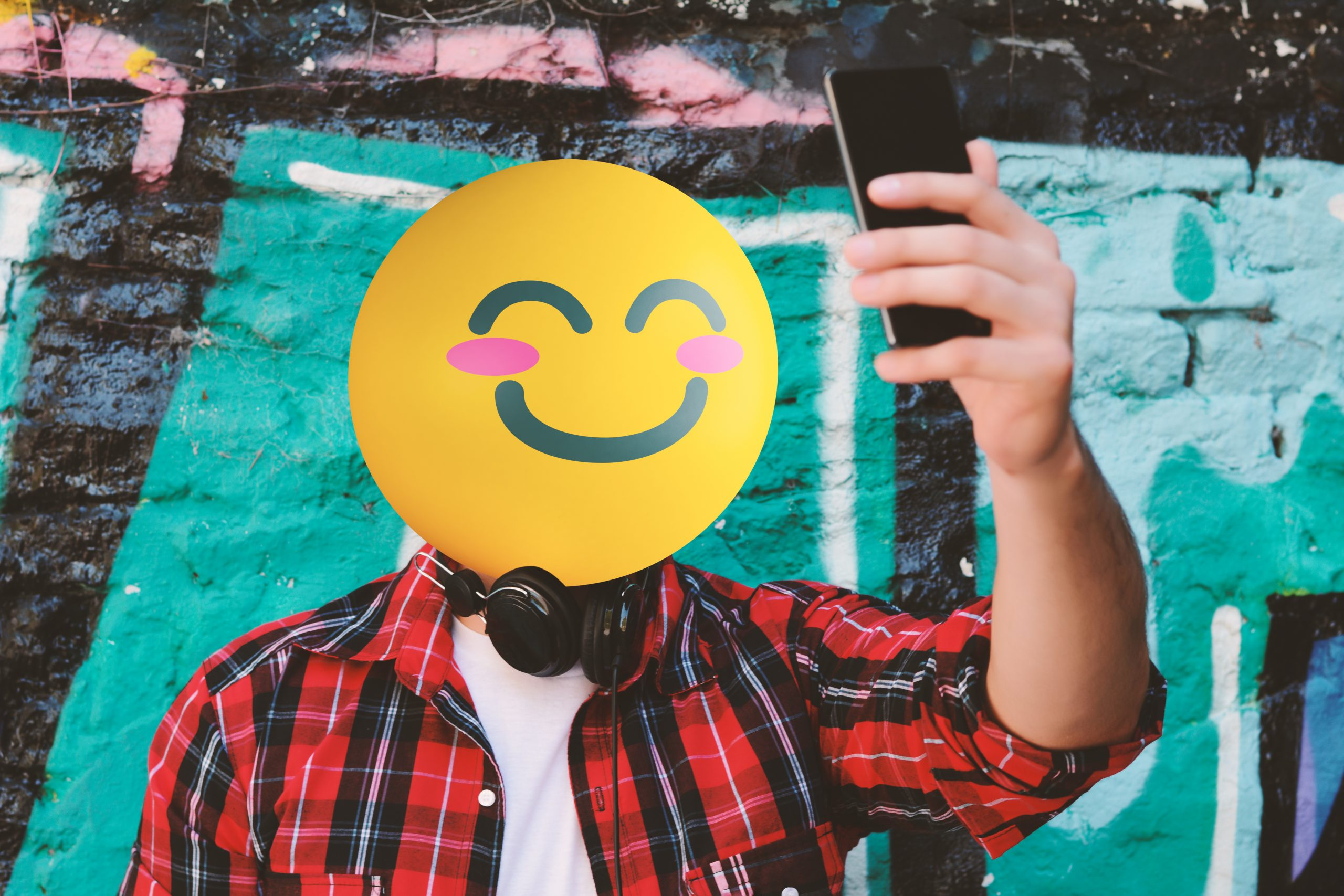 Emoji faced man taking a selfie