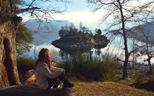 Terpii Travels to Argentina. Girl sitting on an overlook of a lake