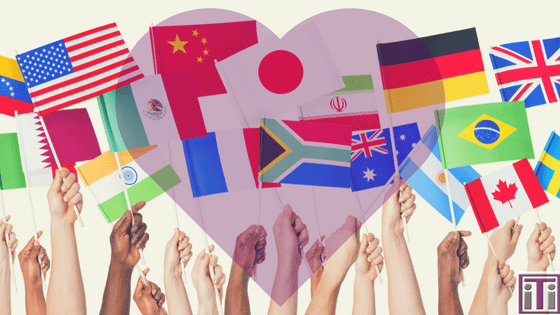 Various country flags being help up with a heart overlay