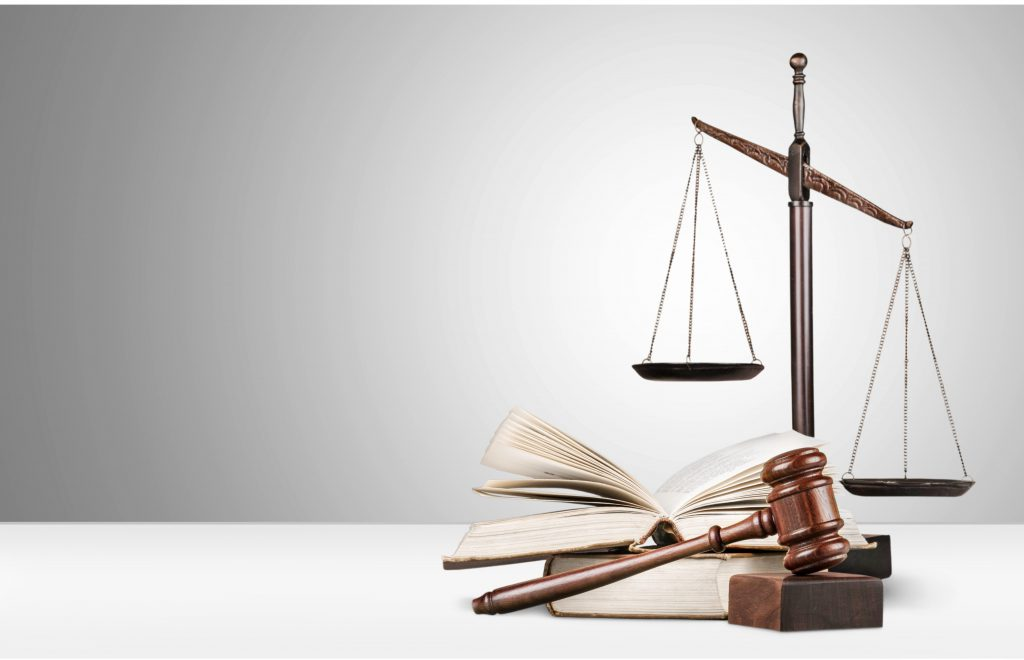 Judges gavel, books, and scales of justice