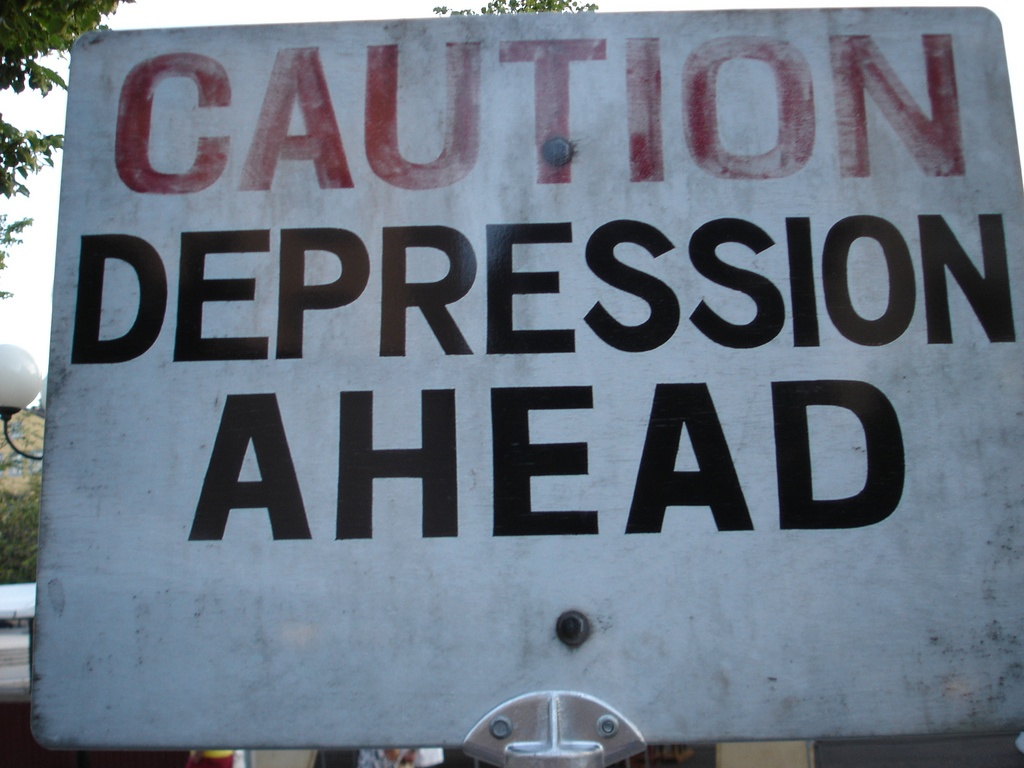 Sign that says caution depression ahead