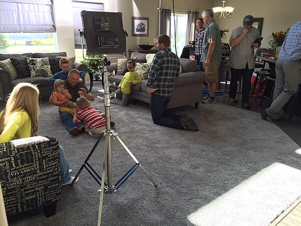 Robinson family filming a commercial in their house