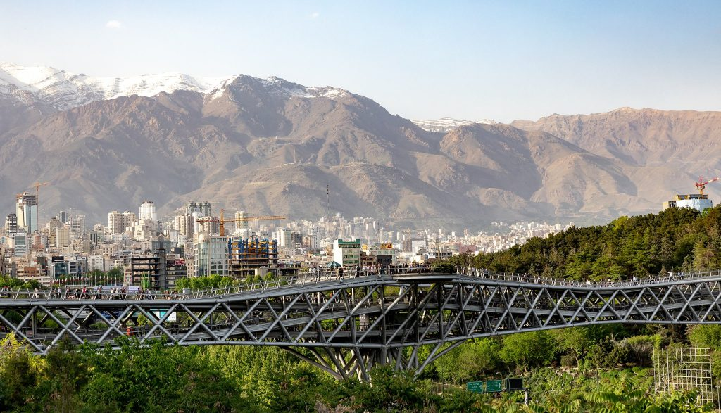 city in Iran with mountains in the background