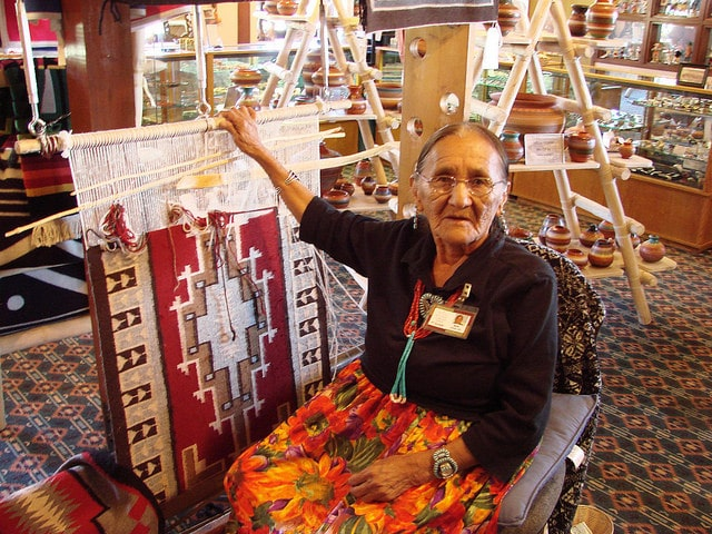 Elderly Navajo women making a rug