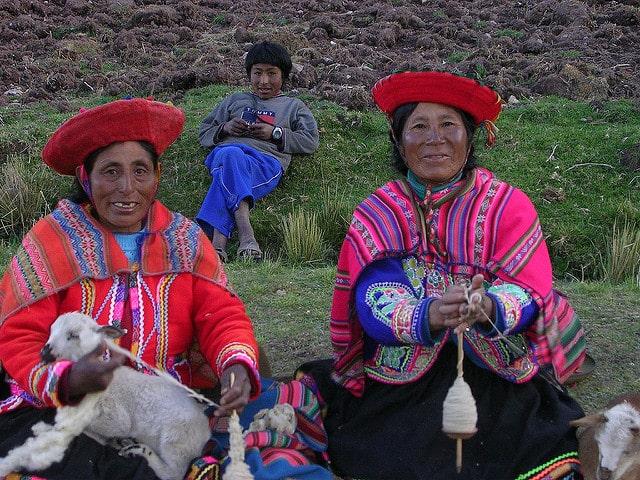 indigenous quechua women holding goats