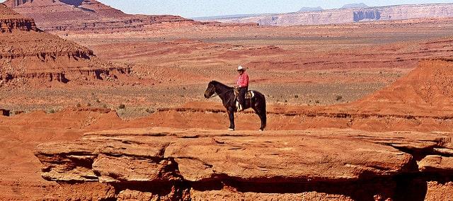 Native American Navajo riding a horse in Arizona
