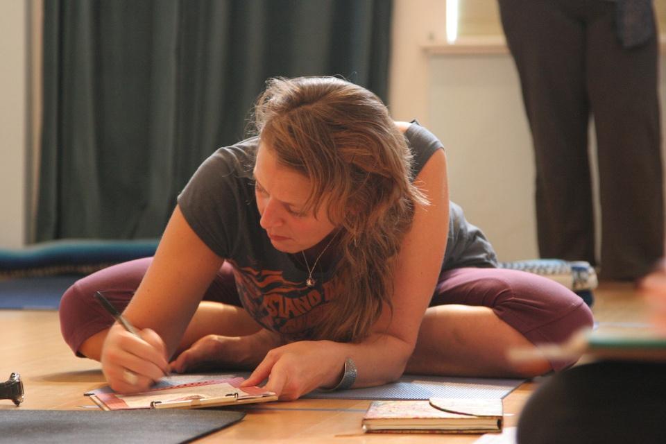 Girl sitting on floor working