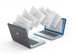 Documents being transferred between laptops for translation