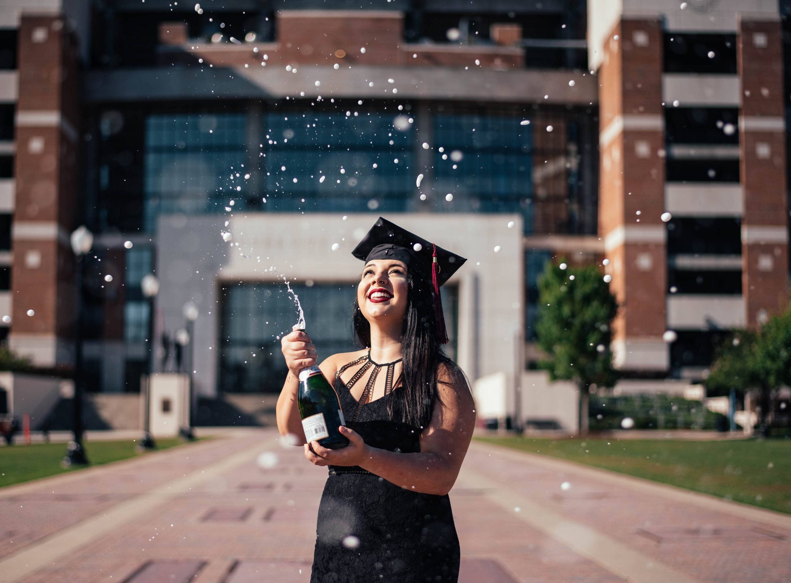 Student Popping Champagne at Graduation - University Language Degrees