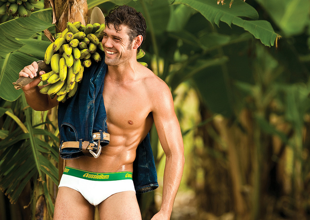 Brazilian model in white underwear holding plantains
