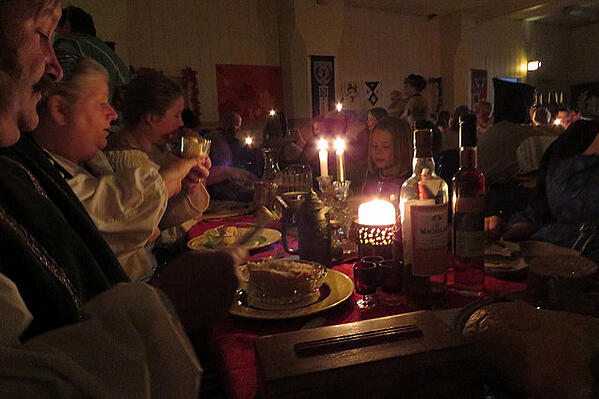 Family dinner over candlelight in Estonia