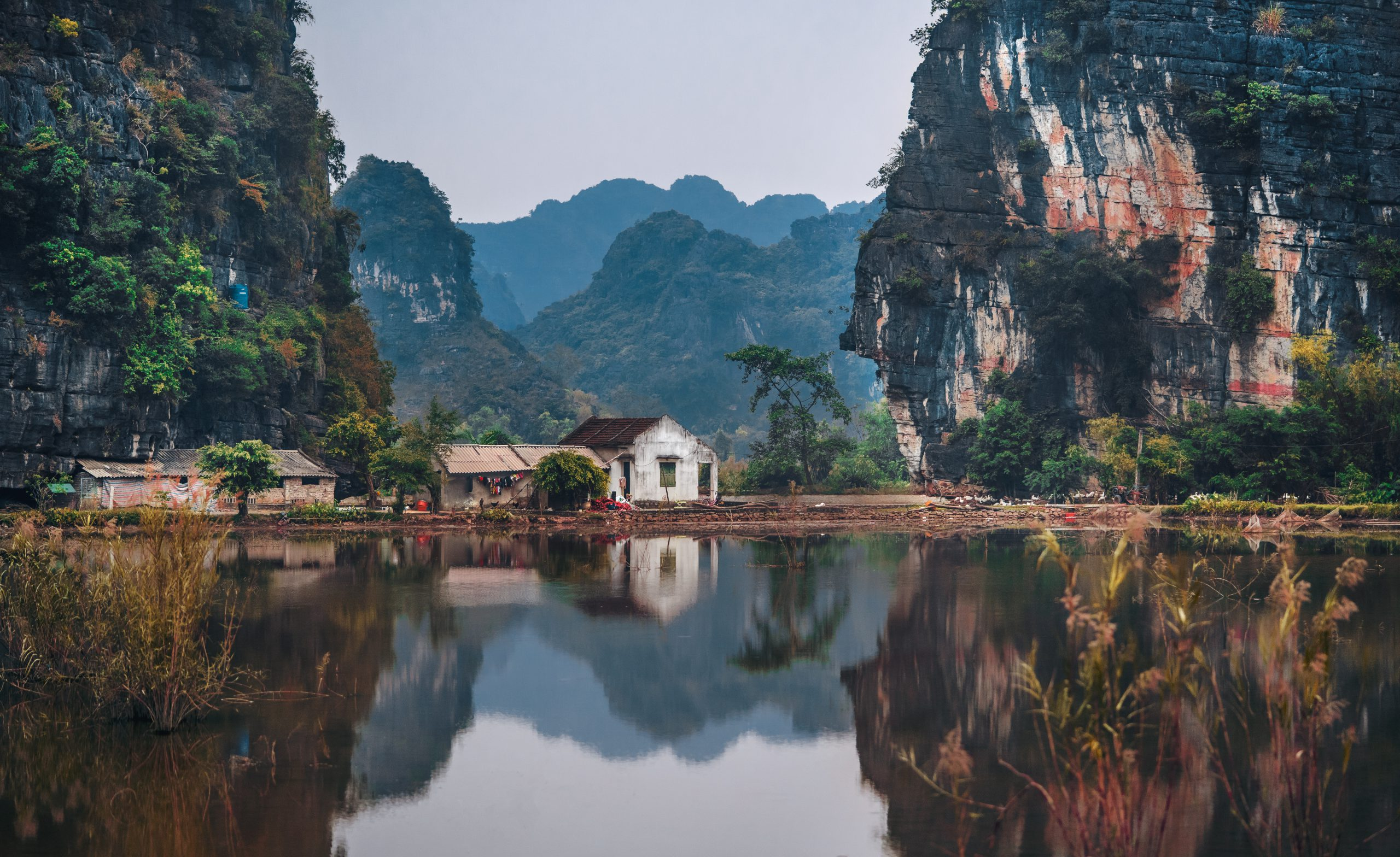 Vietnam mountains with lake and house in front