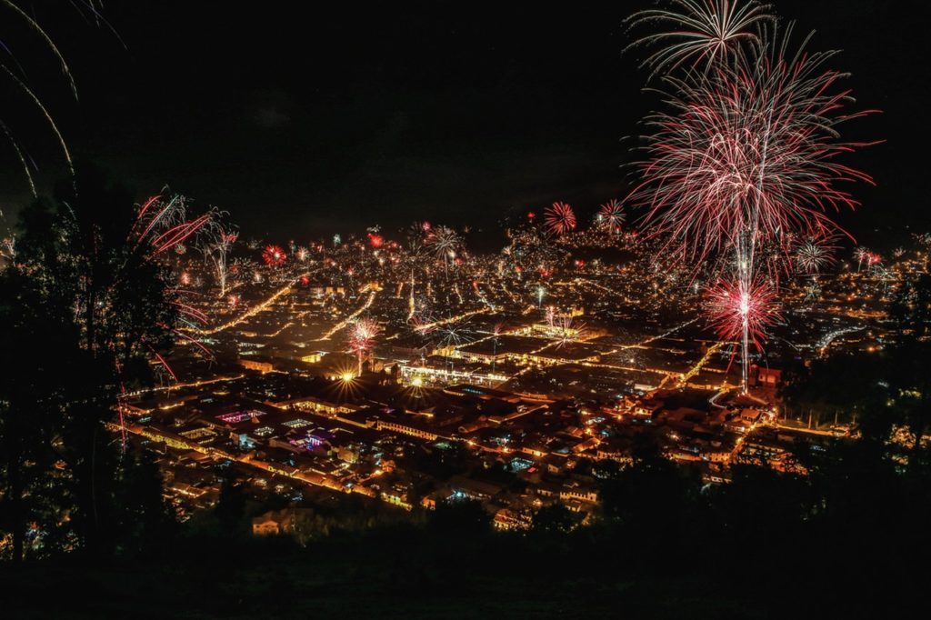 Fireworks over a city at night