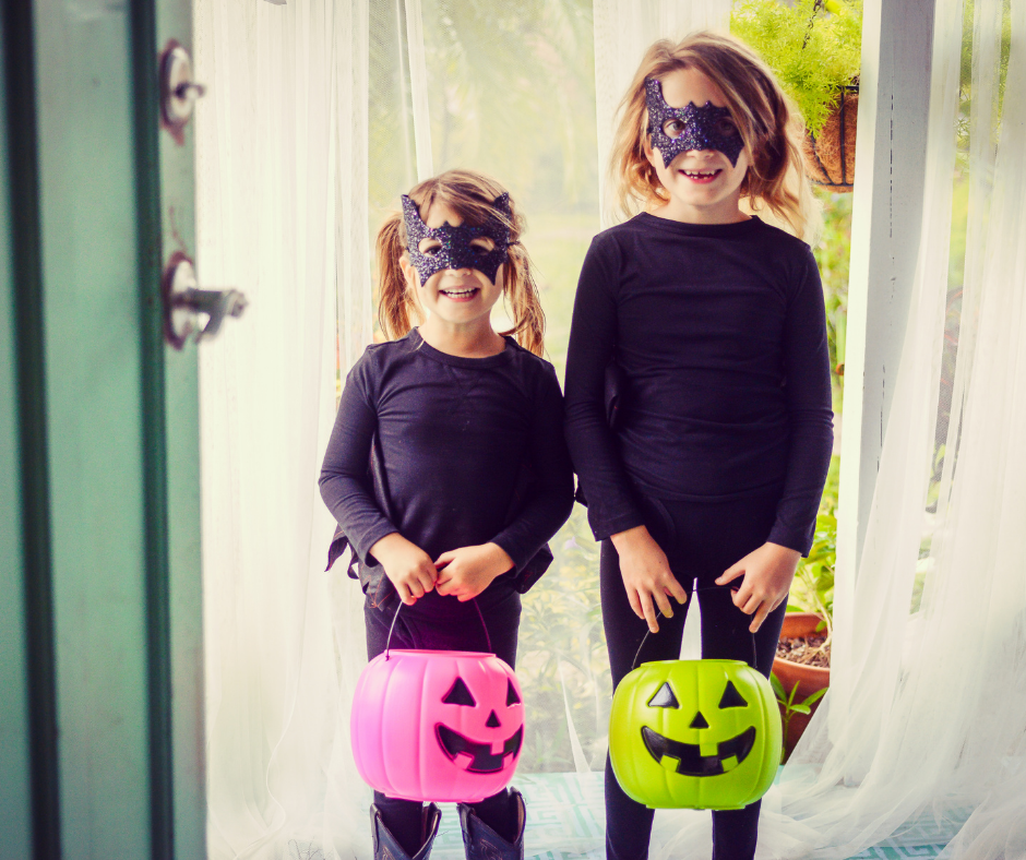 Children in costumes trick or treating