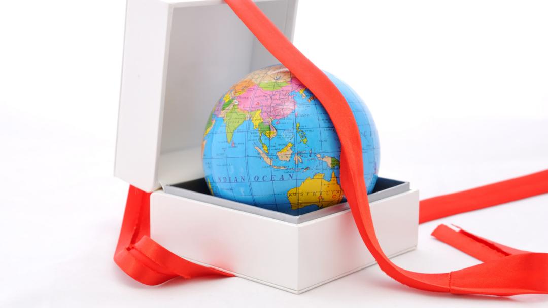 globe inside of a gift box