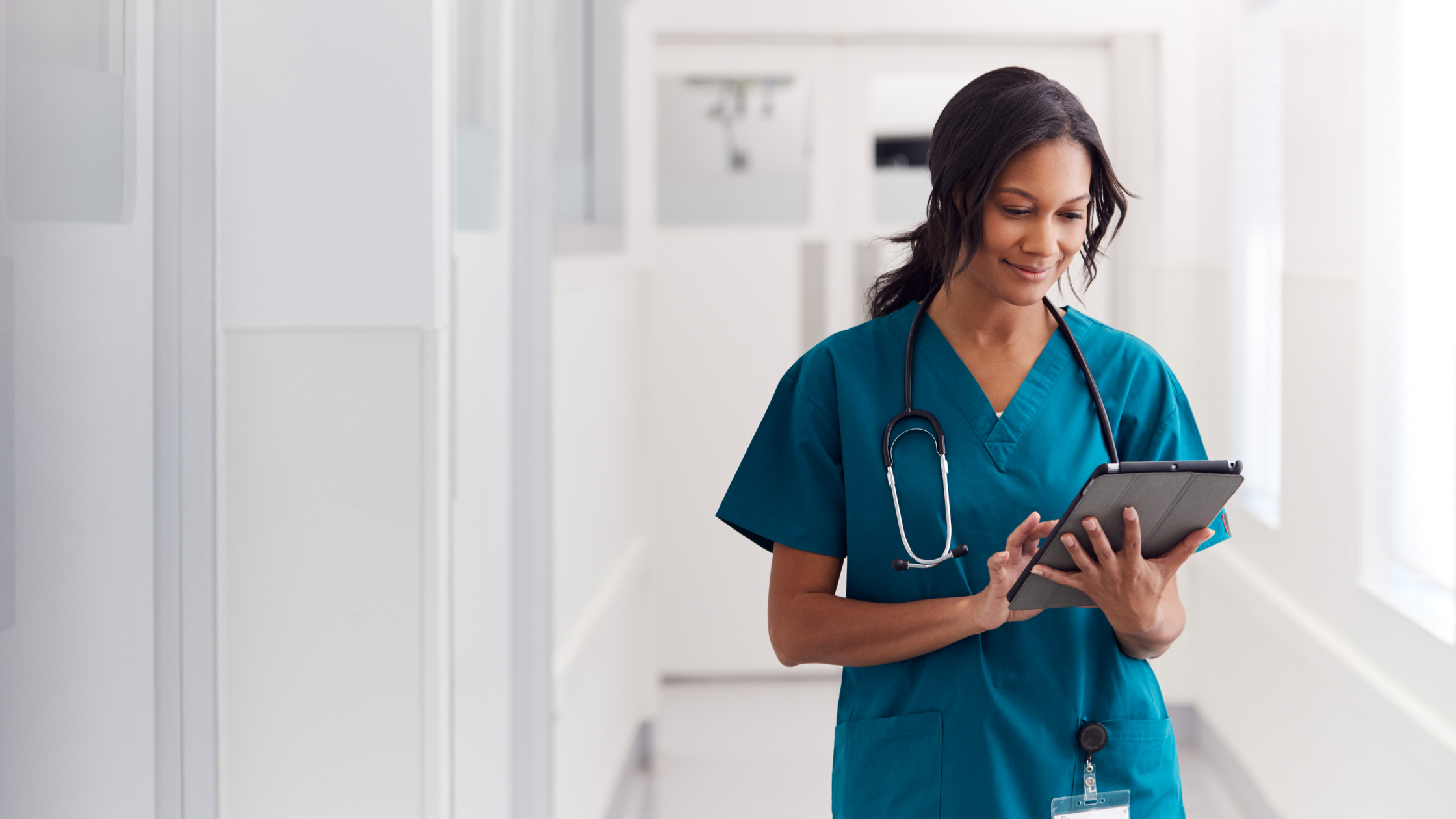 healthcare worker looking at a tablet